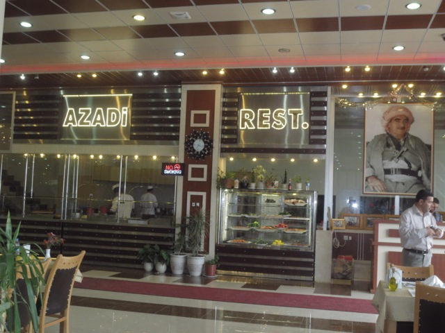 A nice effect/affect. A photo of Barzani the freedom fighter next to the name of the restaurant
